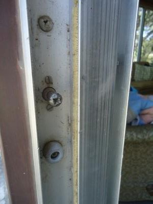 Acorn patio door keeper with rubber bumpers