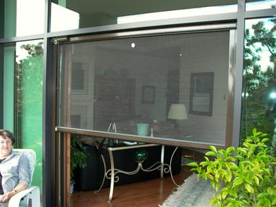 Garage screen door turn your garage into a screen porch for Motorized garage door screens