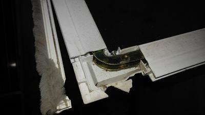 Combination screen door roller and corner